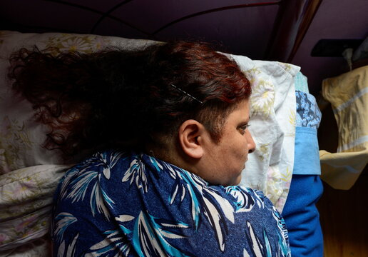 Rosalia Reyes who was sentenced to eight years in prison after her baby died during a home childbirth, rests at her sister's house where she is serving a year of her time under house arrest, in Bahia Blanca