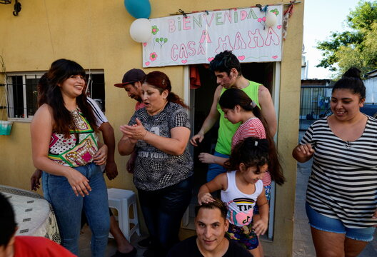 Rosalia Reyes who was sentenced to eight years in prison after her baby died during a home childbirth, reacts with her family after being transferred home where she will serve the rest of her time under house arrest, in Zarate