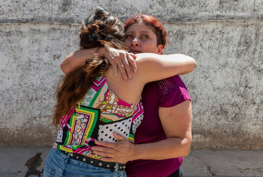 Rosalia Reyes, who was sentenced to eight years in prison after her baby died during a home childbirth, hugs her daughter Vanesa after being transferred home where she will serve the rest of her time under house arrest, in Zarate