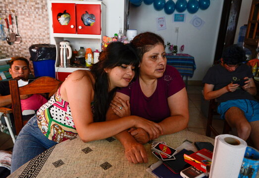 Rosalia Reyes, who was sentenced to eight years in prison after her baby died during a home childbirth, and her daughter hug, after Rosalia was transferred home where she will serve the rest of her time under house arrest, in Zarate