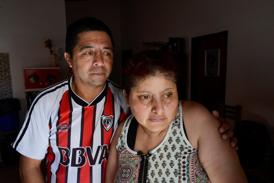 Rosalia Reyes, who was sentenced to eight years in prison after her baby died during a home childbirth, poses for a photograph with her husband after being transferred home where she will serve the rest of her time under house arrest, in Zarate