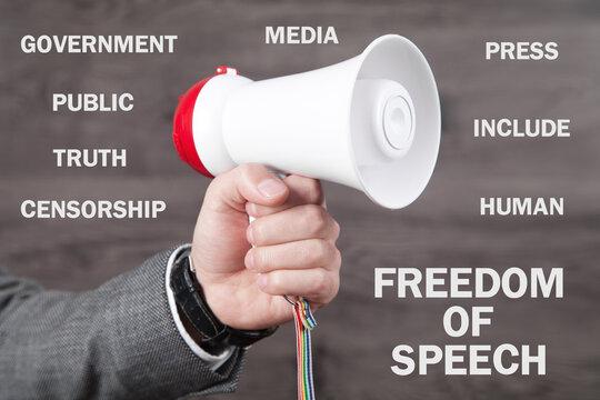 Man holding megaphone. Freedom Of Speech