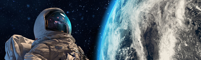 An astrounaut in outer space against the Earth on background