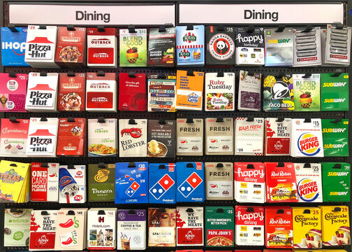 Oakland, CA - Dec 20, 2020: Variety of gift cards displayed at a grocery store. Gift cards give the recipient the freedom to purchase whatever they'd like, up to a certain price.