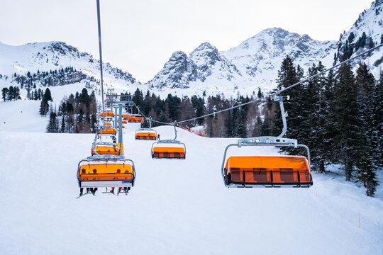 Haus im Ennstal, Austria - December 29 2020: Doppelmayr Alm 6er 6 Seater Chair Lift going up the Mountain in the Hauser Kaibling Ski Area