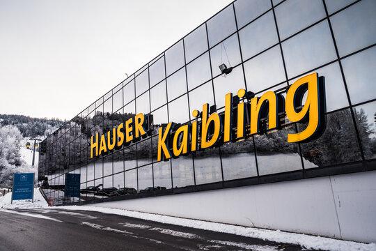 Haus im Ennstal, Austria - December 29 2020: Hauser Kaibling Gondola Lift Station Building Facade with Sign in Winter.