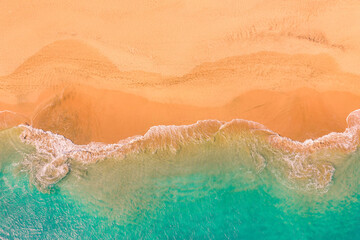 Aerial top down view of beautiful Atlantic ocean coast with crystal clear turquoise water and sandy beach