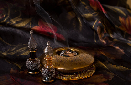 Agarwood, also called aloeswood, essential oil and burning incense chips