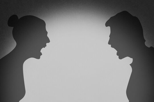 Silhouette of a married couple. Arguing people. Yelling at each other. Showdown. Defending your point of view. Misunderstanding, swearing. Conflict.