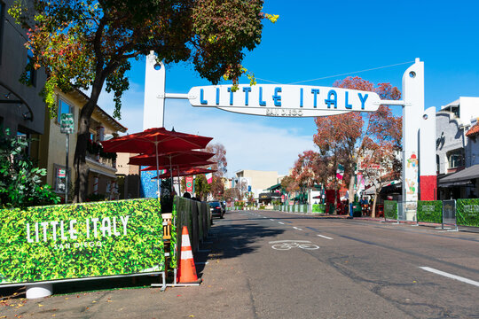 Little Italy sign India Street welcomes visitors to historic tourist destination under blue sky. - San Diego, California, USA - 2020