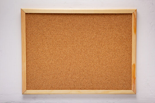 cork board or corkboard at white putty wall background