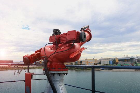 Firefighting foam/ water gun on board of Tanker ship mooring alongside in shipyard.