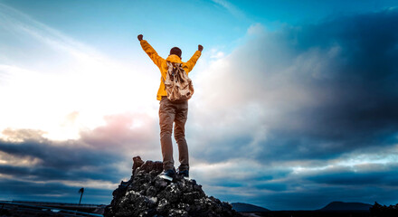 Fototapeta Man with arms up celebrating on top of the mountains - Hiker enjoying freedom on a hill at sunset - Freedom, sport, success and mental health concept obraz