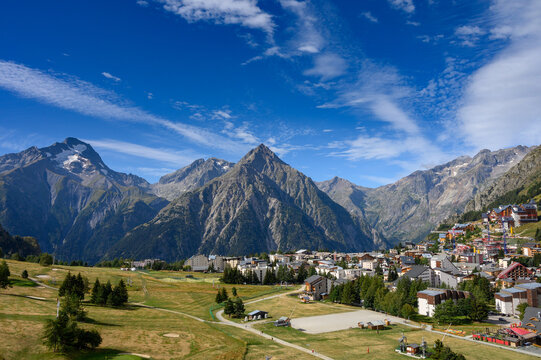 Landscape with view on ski station Les deux Alpes and Alpine mountains peaks in summer, Isere, France