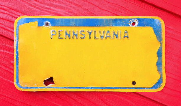 Classic license plate on red background.