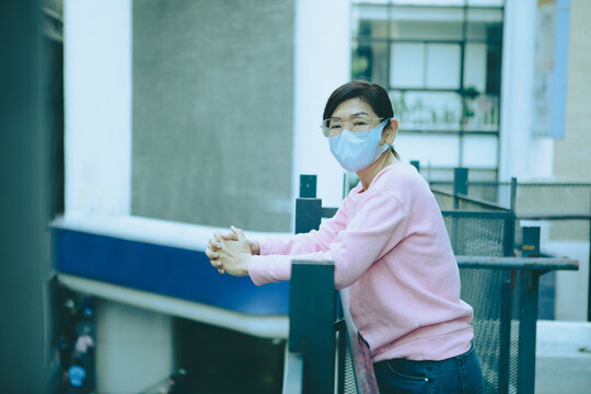 asian woman wearing protection mask standing bulding outside