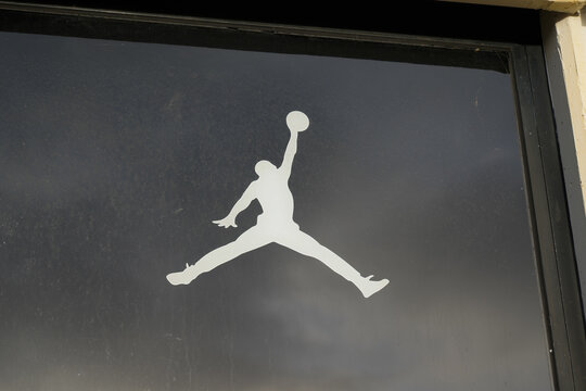 Jordan air Nike Jumpman logo store sign on windows sporty fashion shop