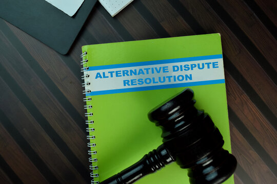 The book of Alternative Dispute Resolution isolated on Wooden Table. Law concept