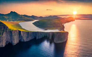 Magnificent evening view from flying drone of Sorvagsvatn lake, Vagar, Faroe Islands, Denmark, Europe. Majestic summer sunset on Atlantic Ocean. Beautiful summer scenery.. - fototapety na wymiar