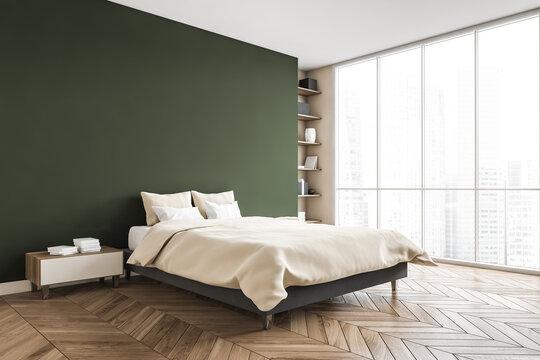 Green and beige bedroom, bed with linens bookshelf near window