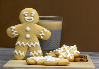 Gingerbread man with glass of cappuccino and cookies