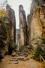 Fototapeta Sandstone cliffs Prachovske Skaly Prachov Rocks, Landscape with colorful trees in nature National Park Cesky Raj in autumn day, rock formation in Bohemian Paradise, Czech Republic