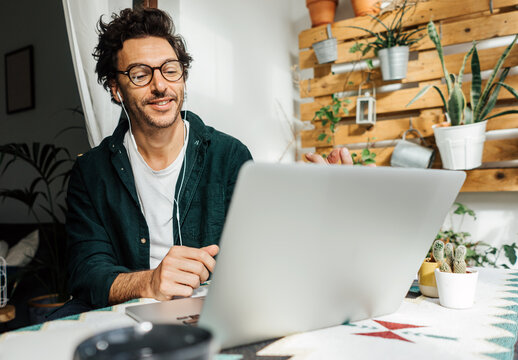 Man with laptop working remotely from home