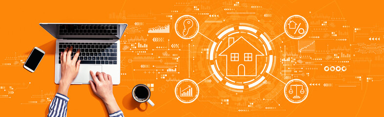 Fototapeta Real estate theme with person using a laptop computer obraz