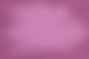 Texture of dark purple paper background with vignette. Structure of  magenta kraft cardboard with frame.