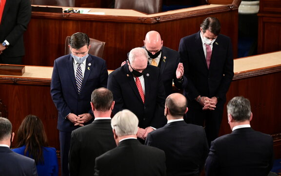 Members of the House of Representatives hold moment of silence for Rep-elect Letlow during the first session of the 117th Congress in Washington