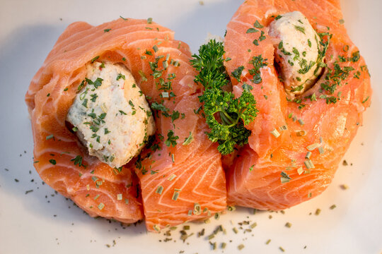 Raw Stuffed Salmon Fillet. Raw salmon with homemade buttery crab stuffing with parsley and herbs.