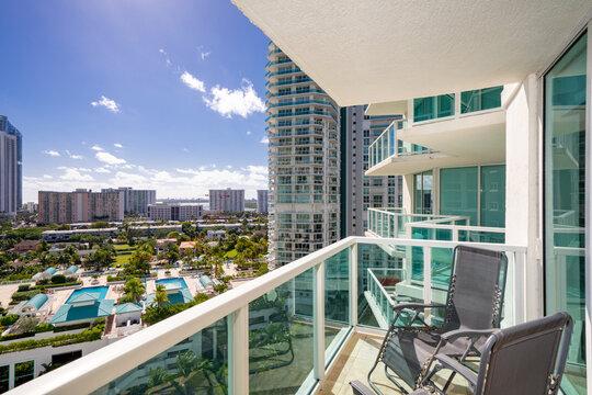 Apartment condominium flat balcony with view of coastal buildings nice scene
