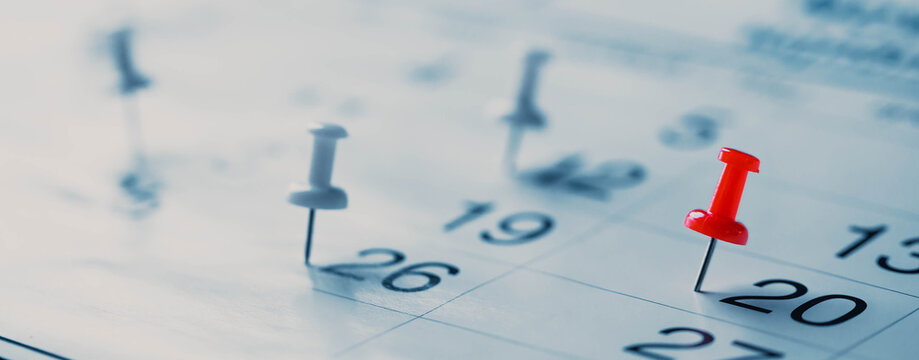 Calendar page pinned in a calender on datebusiness meeting schedule, travel planning or project milestone and reminder concept.