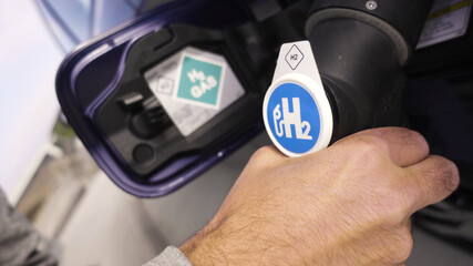Fototapeta Hydrogen Car at hydrogen gas station is being fueled
