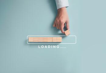 Obraz Download Upload data information and business progressive concept, Businessman putting wooden cube block on light blue background. - fototapety do salonu