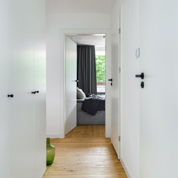 Small white corridor with wooden floor