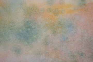Background of abstract watercolour painting on textured paper, pink, blue and orange.