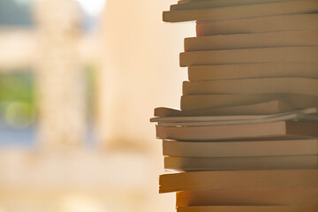Books stack in library with space.
