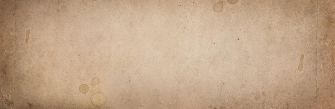 Old vintage wide background paper, rough texture for design paper background. Brown color paper.