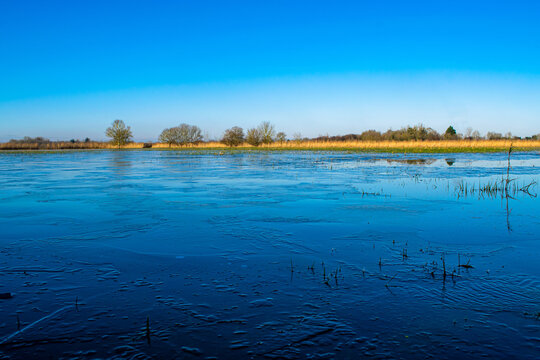 Vendée, France; January 2, 2021: the marshes of blue colors are frozen, winter is here, a superb day with a magnificent sky, not far from Challans.