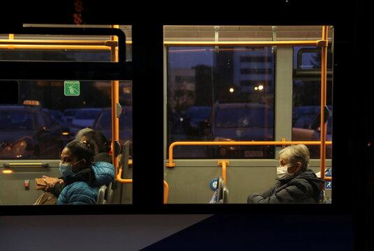 People commute on a bus amid the coronavirus disease (COVID-19) pandemic in Nicosia