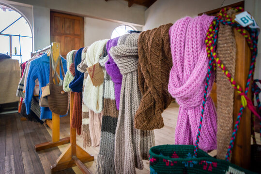 Guaranda, Bolivar Province, Ecuador - November 2013: Wool clothing items in display and for sale, recently manufactured, in a small humble local shop.