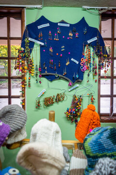 Guaranda, Bolivar, Ecuador - November, 2013: Inside a local shop, with many wool products, such as hats and sweaters. Also for sale are earrings, pendents, necklaces and other imitation jewelry.