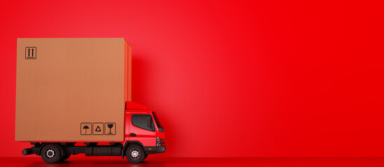 Big cardboard box package on a red truck ready to be delivered