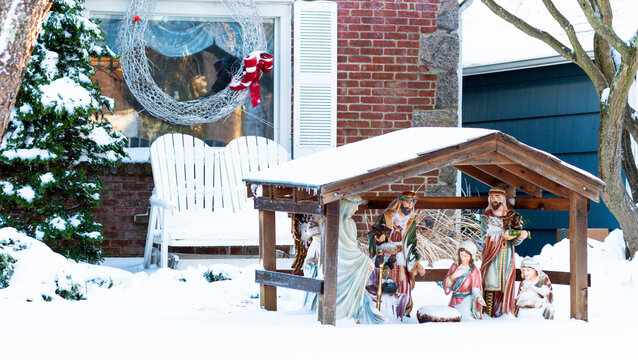 Nativity manger scene decoration on front lawn after it snowed