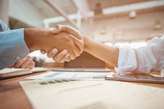 Shaking hands. Happy to work together, before the meeting.Business Financial Concept.