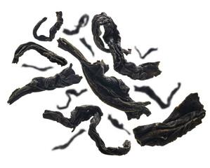 Dried black tea close up levitating on white background
