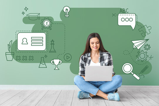 Female student with laptop sitting near color wall. Concept of online education