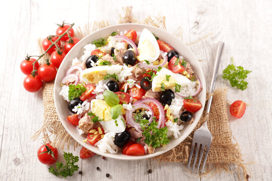 rice salad with egg, tomato, olive and onion