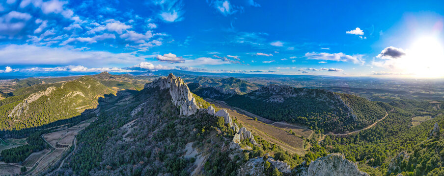 Aerial view of les Dentelles de Montmirail in front of the Mont Ventoux in the french alps